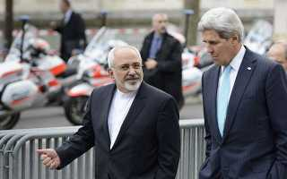 "Foto Jefes de la diplomacia de Irán y EEUU, del artículo del Times of Israel ""Kerry, Zarif to meet in Geneva as nuke talks ramp up"" (2013)."